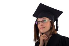 Chica joven en la capa del estudiante que mira soñador Fotografía de archivo libre de regalías