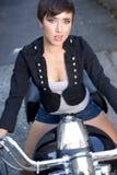 Chica joven en la motocicleta Foto de archivo libre de regalías