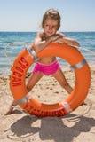 Chica joven en la playa Imagen de archivo libre de regalías