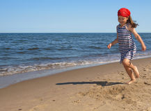 Chica joven en la playa Foto de archivo