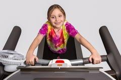 Chica joven en la rueda de ardilla Foto de archivo libre de regalías