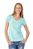 Chica joven en la sonrisa de la ropa casual Fondo blanco Foto de archivo libre de regalías