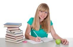 Chica joven en la tabla con los libros Imagenes de archivo