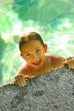 Chica joven en piscina Fotografía de archivo libre de regalías
