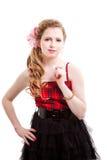 Chica joven en rojo y negro Foto de archivo libre de regalías