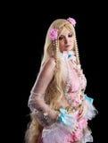 Chica joven en traje cosplay de la muñeca del fairy-tale fotografía de archivo