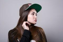 Chica joven en un casquillo Foto de archivo libre de regalías