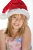 Chica joven en un sombrero de santa Imagenes de archivo