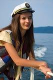 Chica joven en un yate Foto de archivo