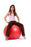 Chica joven en una bola del ejercicio Foto de archivo libre de regalías