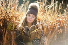 Chica joven en una caña Fotografía de archivo libre de regalías