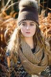 Chica joven en una caña Foto de archivo