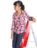 Chica joven en una escalera III Imagen de archivo