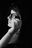 Chica joven en vidrios Fotografía de archivo libre de regalías