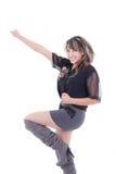 Chica joven feliz con el brazo y la pierna para arriba Fotografía de archivo