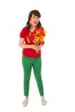 Chica joven feliz con las flores fotos de archivo