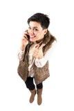 Chica joven feliz con sonrisa dentuda y el pulgar encima del gesto Fotos de archivo libres de regalías