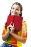 Chica joven feliz con sonrisa roja del libro Foto de archivo libre de regalías