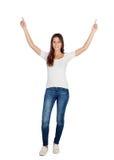 Chica joven feliz con sus brazos para arriba Fotografía de archivo libre de regalías