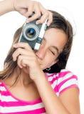 Chica joven feliz de la diversión que toma una foto Fotos de archivo libres de regalías