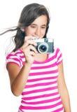 Chica joven feliz de la diversión que toma una foto Imagen de archivo libre de regalías
