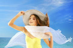 Chica joven feliz en la playa Imagen de archivo libre de regalías