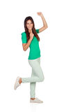 Chica joven feliz que celebra algo Imagen de archivo
