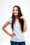 Chica joven feliz que destaca el finger Imagen de archivo libre de regalías