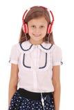 Chica joven feliz que escucha la música Imagen de archivo
