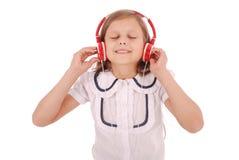 Chica joven feliz que escucha la música Fotografía de archivo