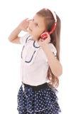 Chica joven feliz que escucha la música Fotos de archivo libres de regalías