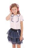 Chica joven feliz que escucha la música Fotografía de archivo libre de regalías
