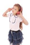 Chica joven feliz que escucha la música Foto de archivo libre de regalías
