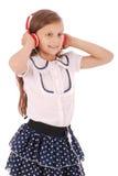 Chica joven feliz que escucha la música Fotos de archivo