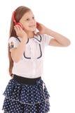 Chica joven feliz que escucha la música Imagenes de archivo