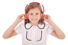 Chica joven feliz que escucha la música Imágenes de archivo libres de regalías