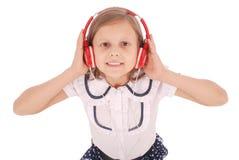 Chica joven feliz que escucha la música, visión desde arriba Imágenes de archivo libres de regalías