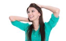 Chica joven feliz que mira el lado en la blusa verde aislada encendido Fotografía de archivo