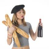 Chica joven francesa con pan y vino Imagen de archivo