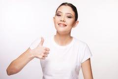 Chica joven hermosa con el apoyo Imagen de archivo libre de regalías