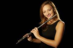 Chica joven hermosa con la flauta Imagen de archivo