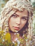 Chica joven hermosa con las coletas Foto de archivo libre de regalías