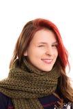 Chica joven hermosa en el guiño de la ropa del invierno Fotos de archivo libres de regalías