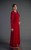 Chica joven hermosa en un vestido histórico Fotos de archivo