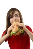 Chica joven que come el emparedado sano Fotos de archivo