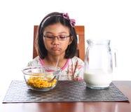 Chica joven que desayuna III Imagen de archivo libre de regalías