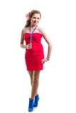 Chica joven que desgasta la alineada roja Imagenes de archivo