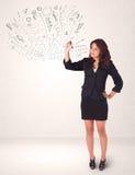 Chica joven que dibuja y skteching líneas abstractas Imagen de archivo