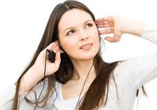 Chica joven que escucha la música Foto de archivo libre de regalías