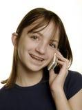 Chica joven que habla en el teléfono celular Imágenes de archivo libres de regalías